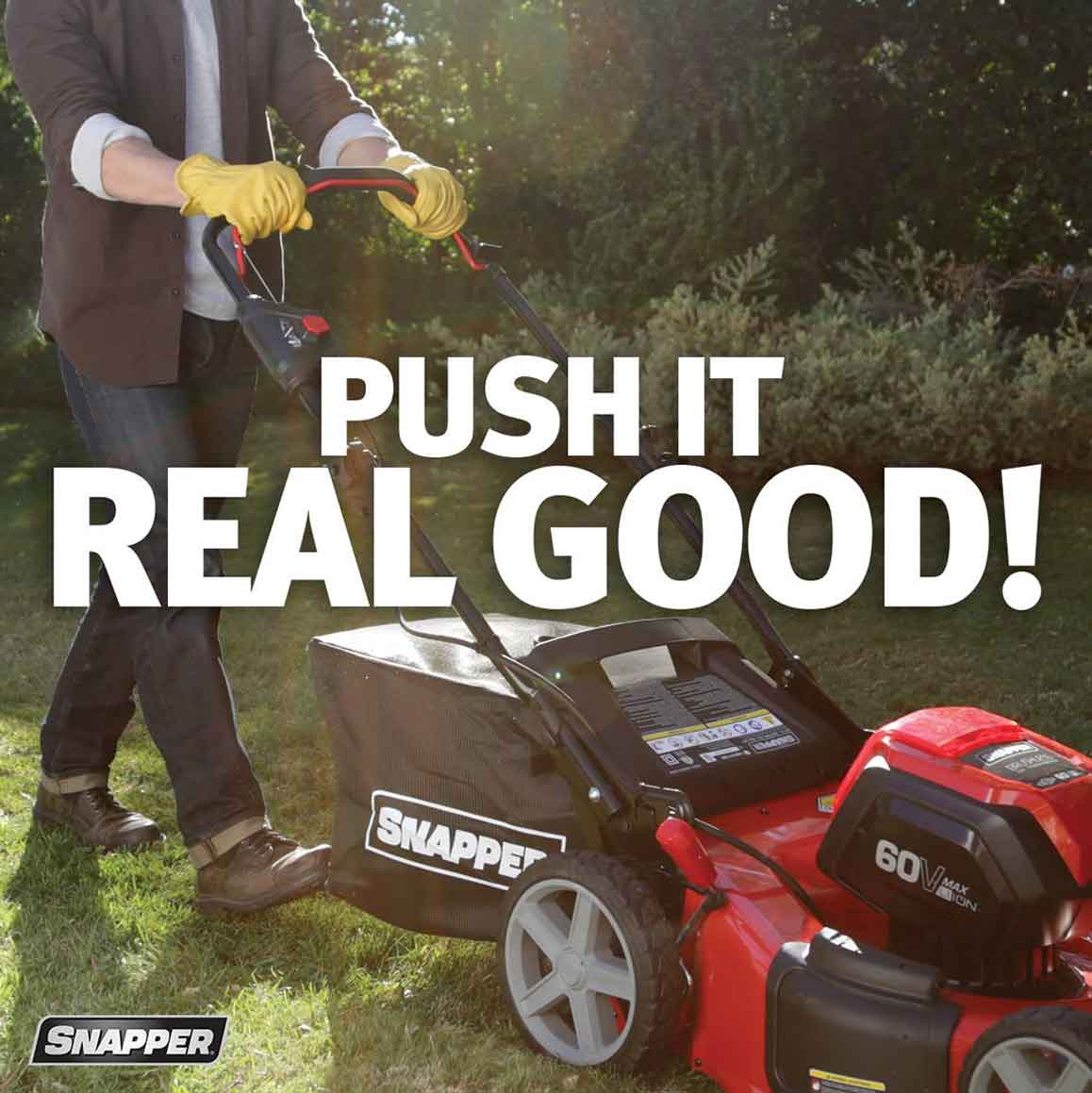 Man wearing dark denim jeans and a brown blazer pushing a red Snapper mower over green grass. White copy on the image reads Push It Real Good.