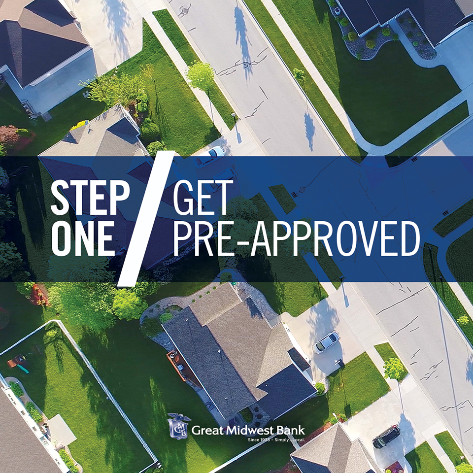 "A high overview of a street lined with houses and green lawns is covered slightly by a graphically designed blue bar with white text reading ""Step 1: Get Pre-Approved"""